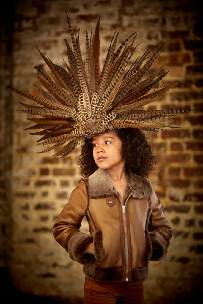 Headdress, £450, Astrobohemia. Leather flight jacket, from £658, 4-14yrs, John Galliano.
