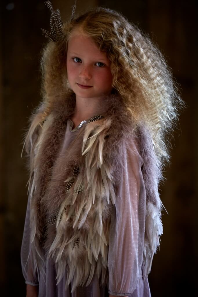 MOLLY wears glitter dress, £75, 4-13yrs by I Love Gorgeous. Feather gilet, £90 by Top Shop.