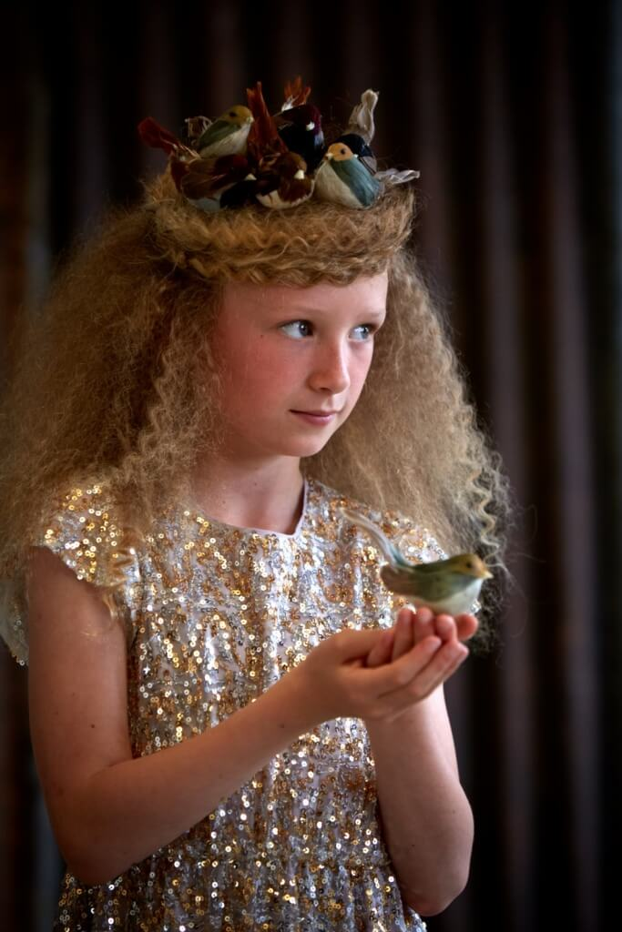 MOLLY wears sequin dress, £95, 4-13yrs by I Love Gorgeous. feather birds stylists own!