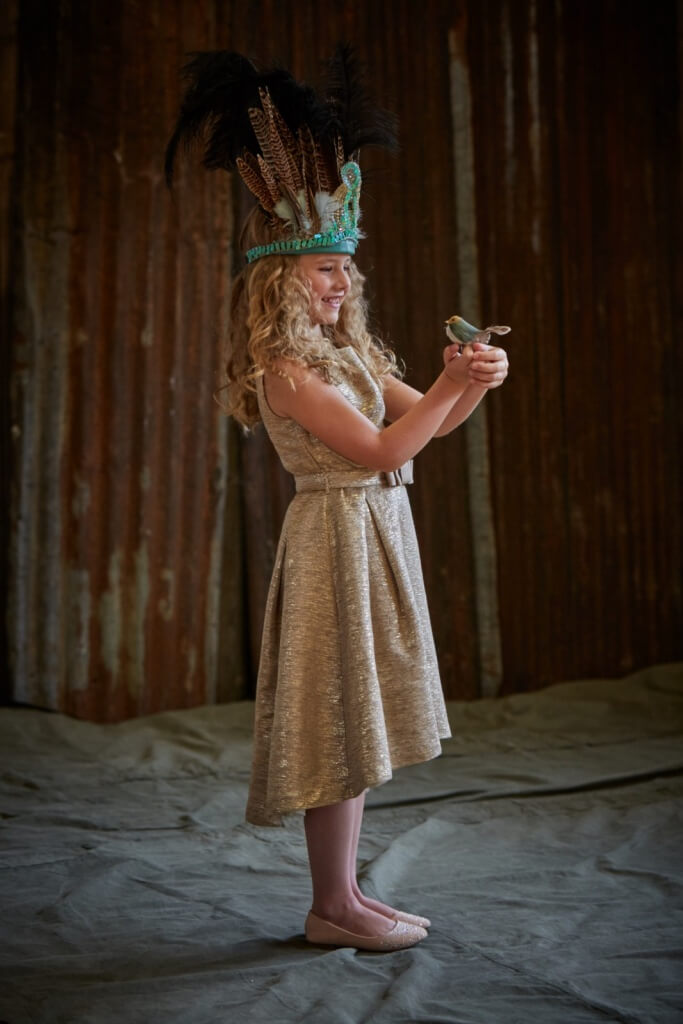 EMILY wears headdress, £350 by Astrobohemia. Dress, £195, 3-12yrs by Marie-Chantal. Shoes, John Lewis