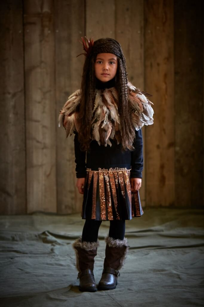 LEILA wears dress from £185, 4-14yrs by John Galliano Kids. Feathered cape, £45, Top Shop. Boots, Beyond Retro.
