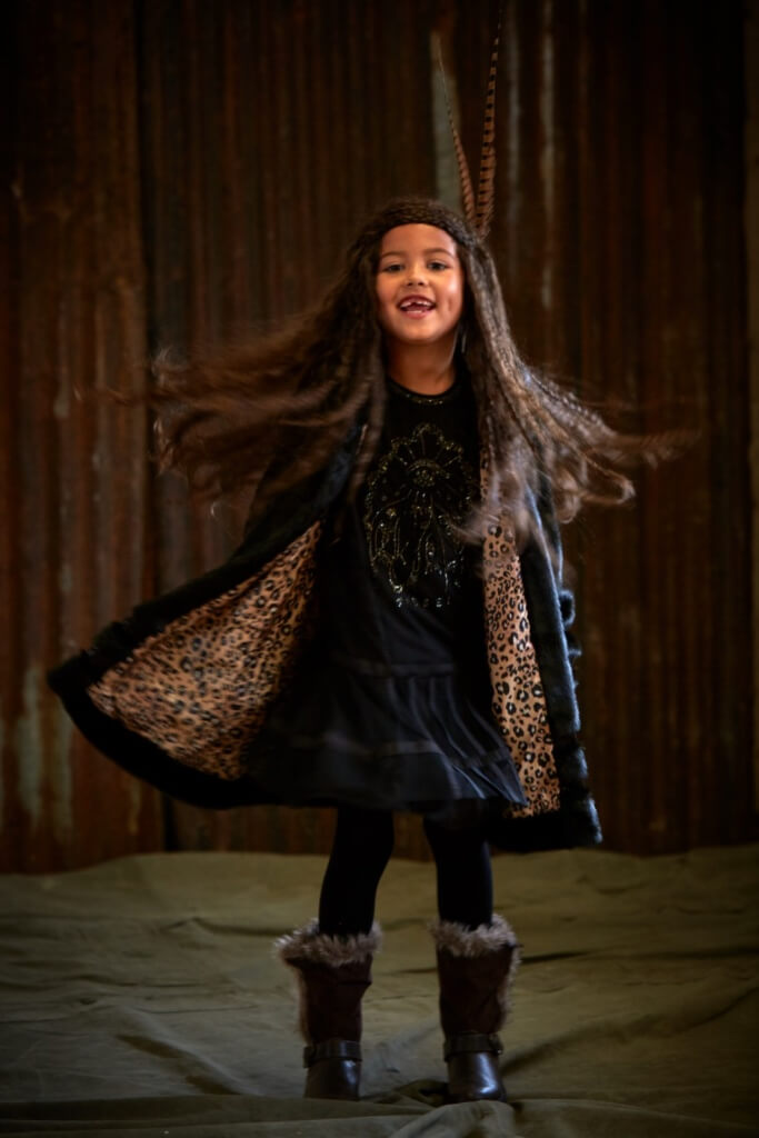 LEILA wears dress from £112 and coat from £145 both 4-16yrs by Diesel Kids.