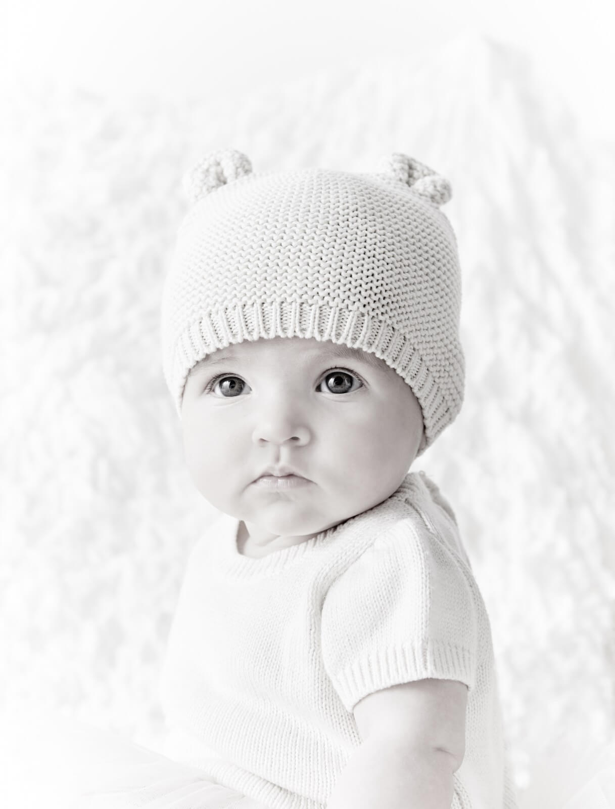 Lily wears cotton knit hat, £6.95 and dress, £29.95 both Gap.