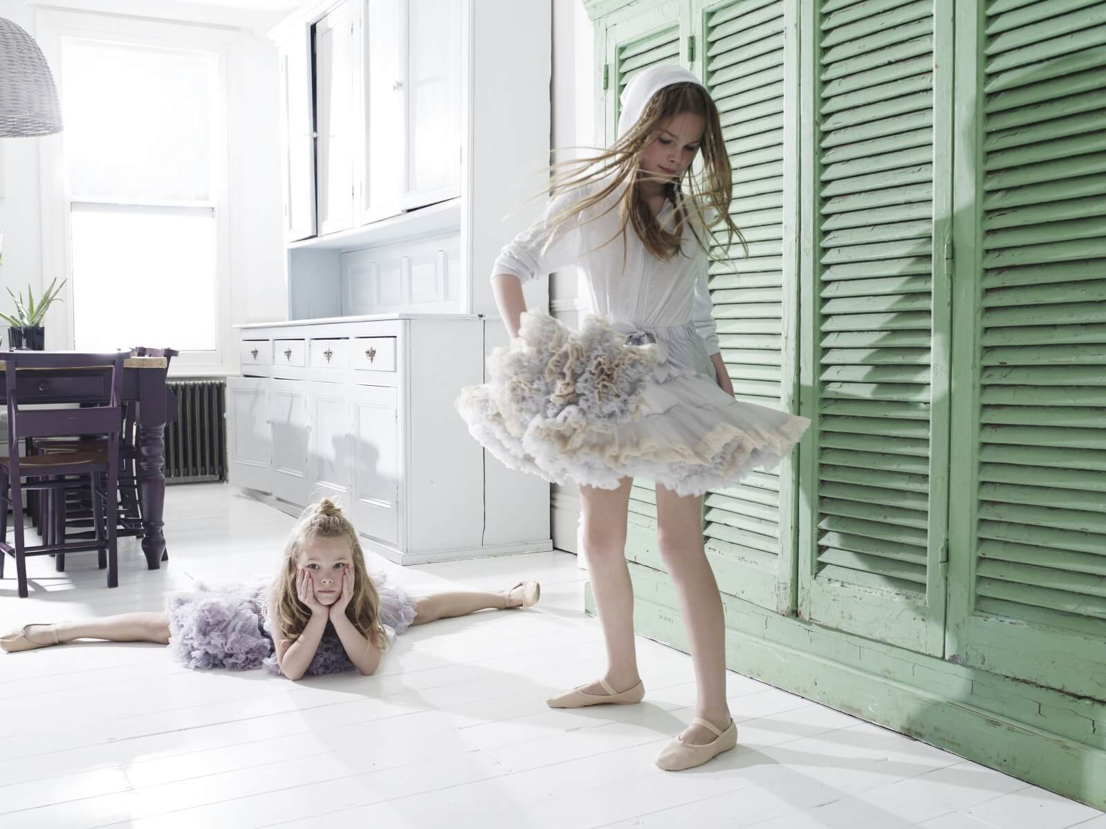 Poppy wears lilac frilled tutu dress, from £56, 0-13Y, Angel's Face at Childrensalon. Freya wears silver zipped hoodie, £57.50, 4-14Y, Eleven Paris. Grey and ivory chiffon tutu skirt, from £36, 0-13Y, Angel's Face at Childrensalon.