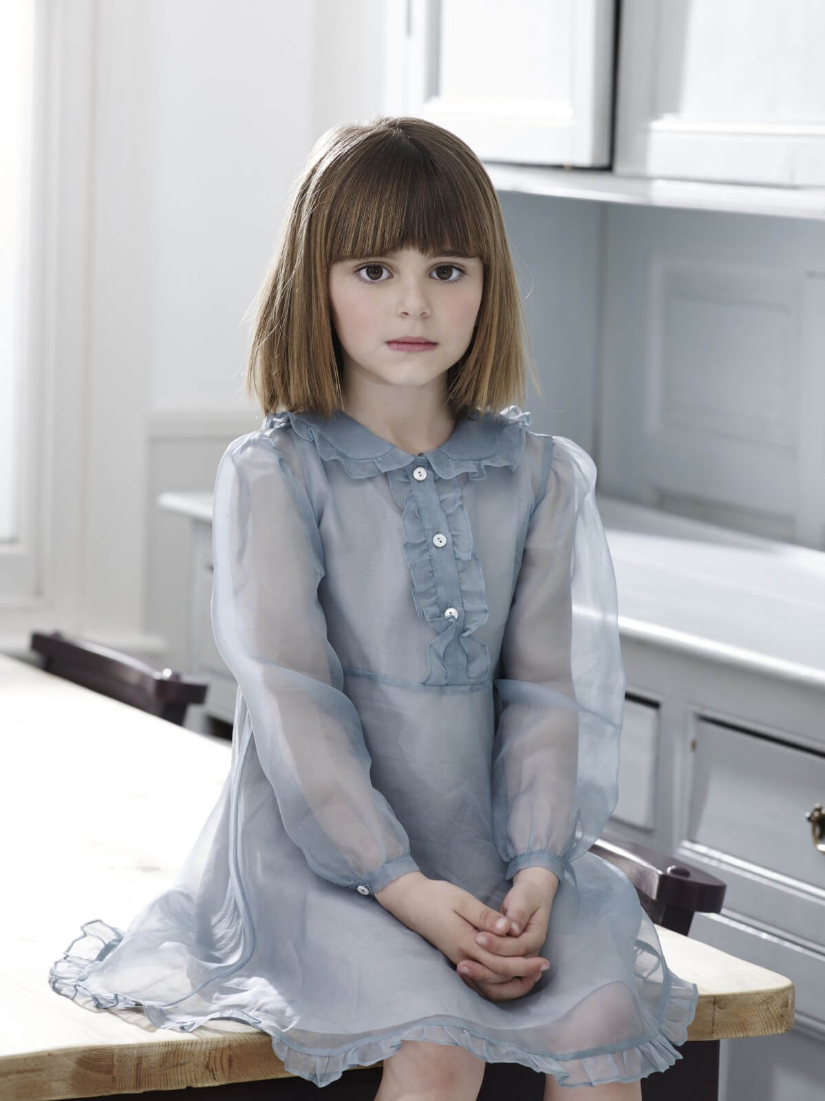 Meg wears pale blue organza dress, from £125, 3-12Y, Caramel Baby & Child.