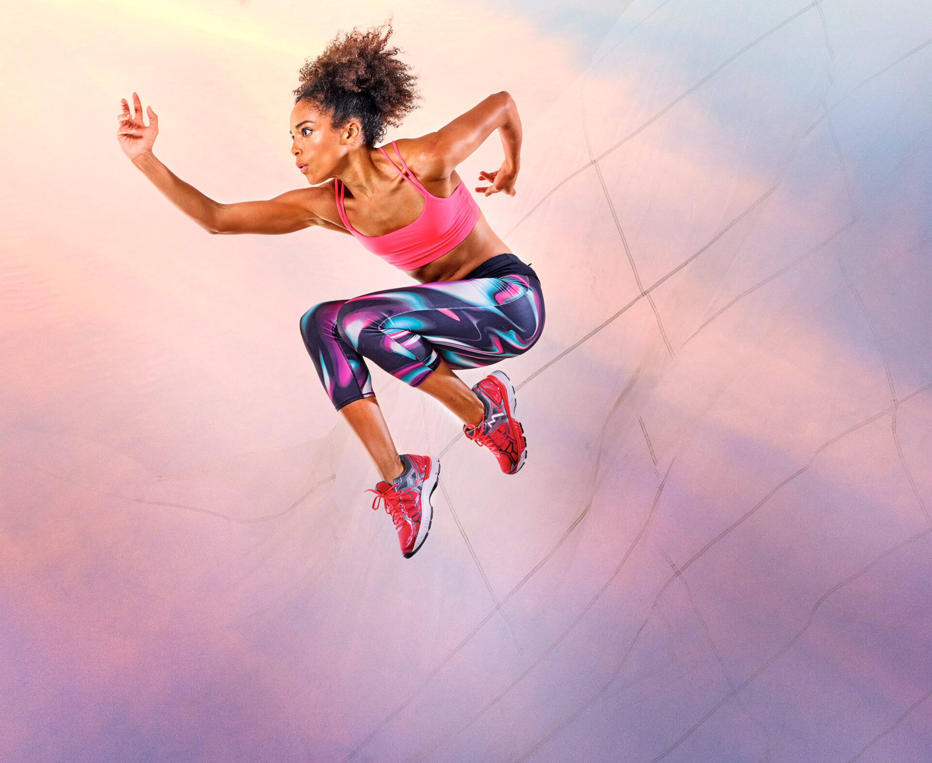Portia wears Pink cropped top by Gap Active. Print leggings by M&S Activewear. Trainers by 361 Sports.