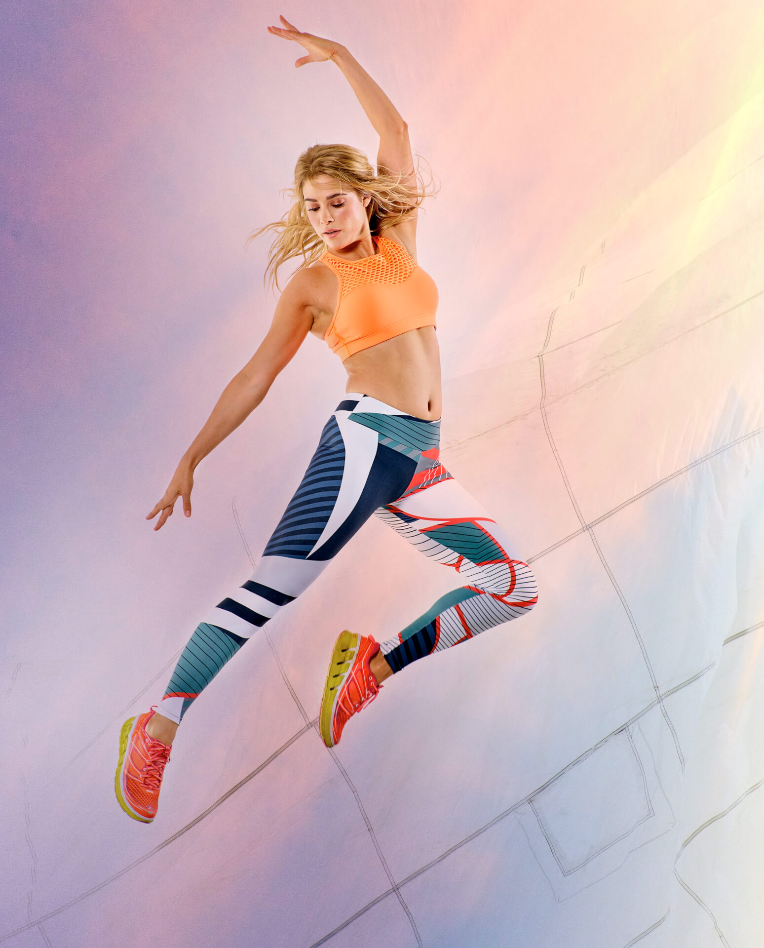 Orange cropped top by Lorna Jane. Leggings by Style Sportif. Trainers by Hoka One One.